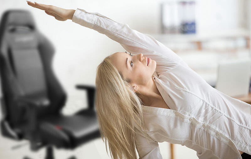 Woman stretching in front of a gaming chair