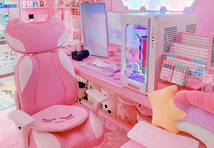 Pink Kitty gaming chair inside a pink gaming workstation