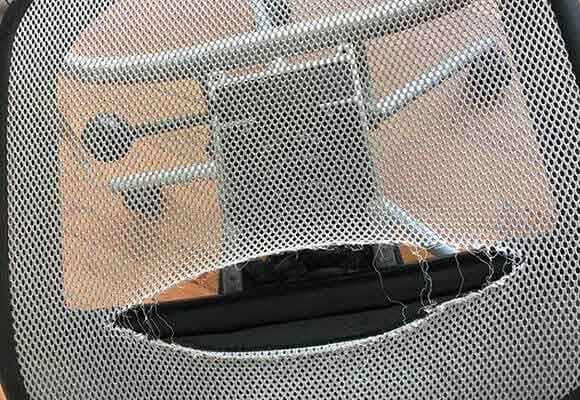 Torn mesh office chair